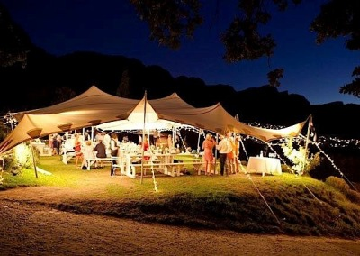 kilobush-stretch-tents-nighttime-wedding-setup